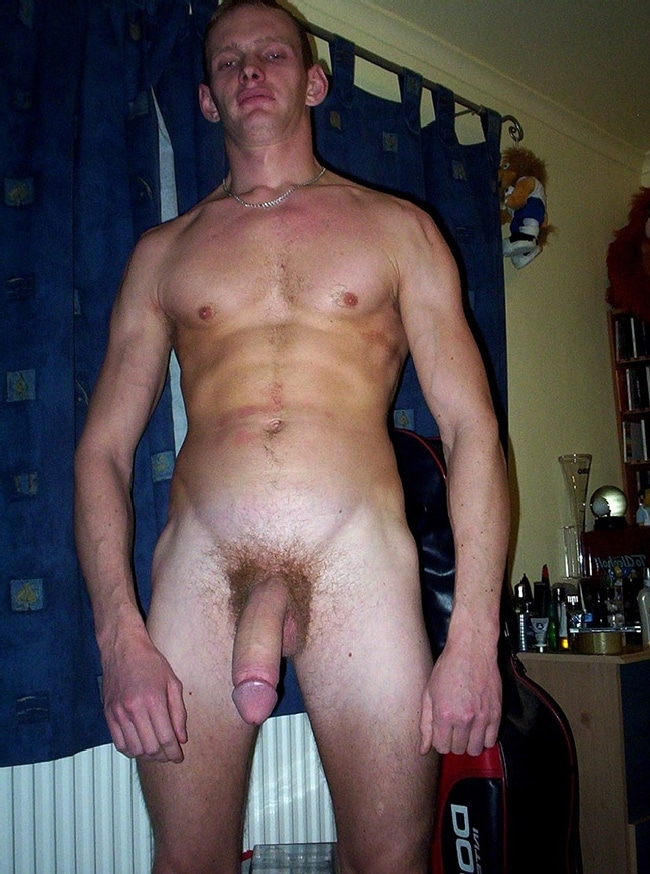 Nude Hung Man Posing For The Camera